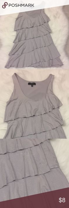 Silver / Grey Tiered Top, size XS or Small Lovely top! Hides any midsection imperfections. Size XS, can fit size small too. Worn twice and washed, has a tiny discoloration as a result but can barely see it (see pic 3, it's like a light, light pinkish color). Marked low to reflect that imperfection. Express Tops Tank Tops