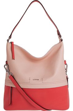 This impeccably designed hobo bag cast in smooth pink leather provides enough room for the smartphone and other essentials, while an optional shoulder strap allows hands-free ease during your busy day.