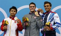 Gold medalist David Boudia of the U.S. poses on the podium with silver medalist Qiu Bo (L) of China and bronze medalist Tom Daley (R) of Britain