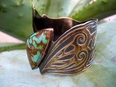 Cuff | Silvia Peluso ~ SilviasCreations.   Etching on Patina NuGold and Turquoise.