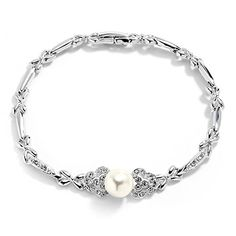 """Mariell Sleek Designer Pearl & Cubic Zirconia Bracelet for Bridal, Wedding or Formals - Platinum Plated. Mariell's Luxurious Soft Cream Pearl Bridal Bracelet; 7"""" long with Lustrous 8mm Pearl with Gleaming CZ Setting. Genuine Silver Platinum Plating with the Look of Fine Jewelry. Finest Quality AAAAA Grade Cubic Zirconia for Diamond-like Brilliance for the Look of Genuine Diamond and Pearl Jewelry. Risk-Free Purchase; 100% Money-Back if Not Delighted; Lifetime Guarantee. Beautifully Packaged…"""