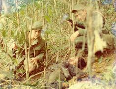 U.S. soldiers with a dead Viet Cong.