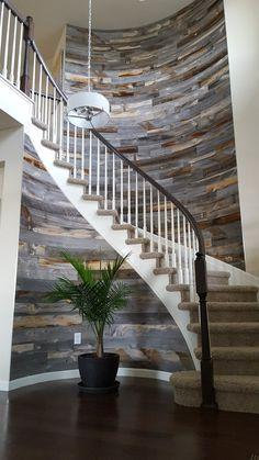 Reclaimed wood wall adds interest to spiral staircase  www.stikwood.com