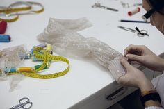 The delicate construction of a lace sleeve. Haute Couture luxury.