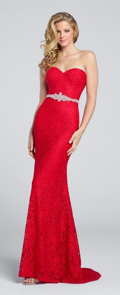 This classic strapless lace fit & flare gown features a sweetheart neckline, crystal detail at natural waist, & slight train. Available in red & royal blue.