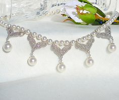Hey, I found this really awesome Etsy listing at https://www.etsy.com/listing/175405515/elegant-crystal-pearl-bridal-necklace