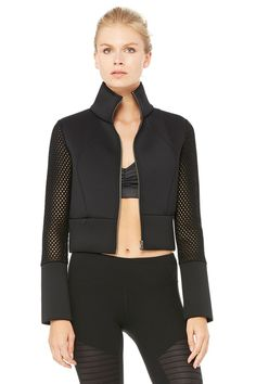 <p>As seen on Gigi Hadid, the Shell Jacket's on-trend cropped bomber style looks great layered over yoga gear (and it transitions to what's after the mat effortlessly). Its scuba-inspired double-face fabric with spongy mesh contrast detail lends style, while the zip- front and hidden waistband pocket make it functional.</p>