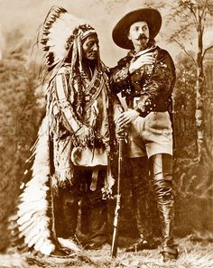 """William F. """"Buffalo Bill"""" Cody posed for this studio portrait with Sitting Bull, famed medicine man and military leader of the Hunkpapa Sioux. Sitting Bull was"""