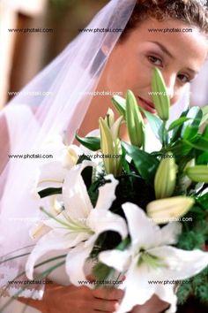 http://www.photaki.com/picture-bride-holding-bouquet_1323439.htm