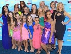 Kristie Ray, Brooke Hyland, Jill Vertes, Kendall Vertes, Holly Frazier, Gianna Martello, Mackenzie Ziegler, Payton Ackerman, Maddie Ziegler, Asia Ray, Paige Hyland, Christi Lukasiak, Chloe Lukasiak, Nia Frazier, Kelly Hyland and Melissa Ziegler on the red carpet of the 2013 Teen Choice Awards