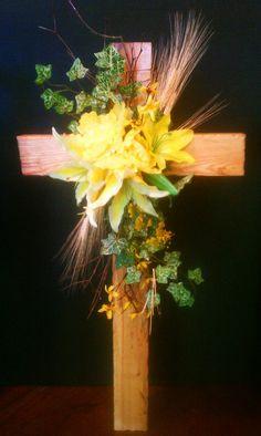 Handmade wooden cross with silk flowers