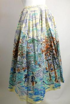 1950s cotton skirt with a gorgeous  print of a Paris street scene,  complete with Eiffel Tower and the  Moulin Rouge. By Nelly deGrab.