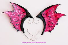 This pair of dragon fin or punk fairy ear wings have a deliciously spiky attitude about them, with bold hot pink membranes and contrasting glossy