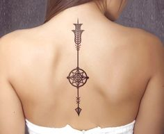 Woman with Downward Arrow Tattoo with Compass on Spine