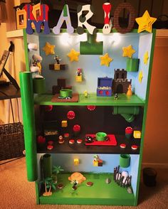 I made this for my sons birthday, has working lights, holes were drilled for pvc piles so characters can drop from level to level. Mario Birthday Party, Mario Party, 6th Birthday Parties, Sons Birthday, Boys Room Decor, Boy Room, Kids Room, Super Mario Room, Mario Crafts