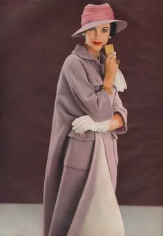 March Vogue 1957    Wearing a wool amethyst coat by Ben Zuckerman and a felt and chiffon hat by Lilly Daché.  Photo by Frances McLaughlin-Gill