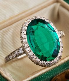 CARTIER - A VERY FINE ANTIQUE EMERALD, DIAMOND AND PLATINUM RING, CIRCA 1910. Set with an oval emerald weighing approximately 3.00 carats, the frame and shoulders pavé-set with old-cut diamonds, mounted in platinum, signed Cartier. Purchased in the 1920s when the family was visiting Cartier in Paris. The family story states that while they were at Cartier, they were introduced to Russian Prince Felix Youssoupoff. The prince was said to have been consigning the ring for re-sale at Cartier.