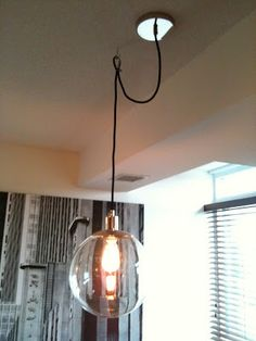 How to Hang a Swag Light and Brighten Any Room   Hook up my Place     Black pendant cable on hook