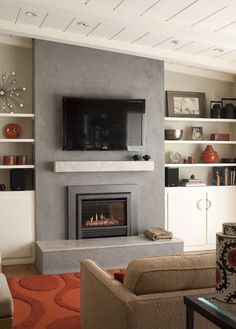Comfy Living Room Décor Ideas With A Corner Fireplace 23 – Modern brick fireplace Fireplace Mantle Designs, Brick Fireplace Mantles, Grey Fireplace, Concrete Fireplace, Home Fireplace, Fireplace Remodel, Modern Fireplace, Living Room With Fireplace, Fireplace Surrounds