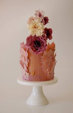 Terracotta rick-red Wedding Cake. Sugar flowers in red, pale yellow and orange colors. Unique cake. Chestnut, ginger, brown cake.