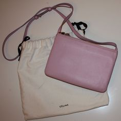 Céline Small Trio in Light Pink Gently worn Céline trio in light pink. Purchased last spring at the Céline store in SoHo. Light signs of wear as seen in photos. Slight discoloration from Jean transfer on the inside on the bag, but you can barely notice. Great bag for spring! Celine Bags Crossbody Bags