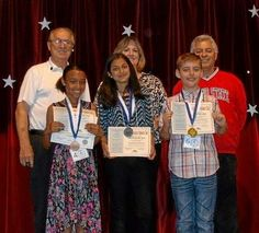 Top finishers in the Pomona Breakfast Optimist Club Oratorical Contest were Ranch Hills Elementary students Jasmine Bryan, Aisha Hakim and Daniel Tranancos. In the back row are Optimist Club's Vernon Price, Robin Schary, Ranch Hills principal, and Robert Martinez, Ranch Hills teacher.