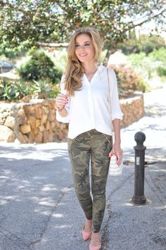 Camo pants, coral bag and flats and white blouse
