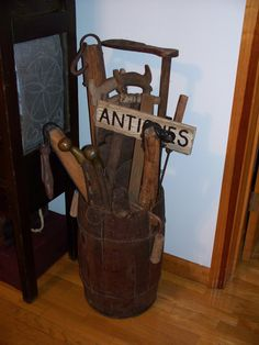 Old nail keg, put old tools and signs in it and display.