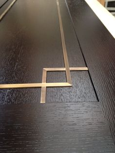 Stained oak doors brass inlays