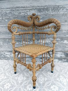 Antique Heywood Brother Wakefield Wicker Corner Chair.....I used to own one like this except it was painted matte black.....beautiful!!