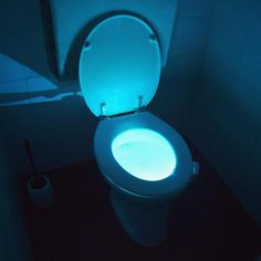 The Toilet Seat Light Glow features a color changing option, so you can choose from a variety of different colors. Led Night Light, Light Up, Toilet Bowl Light, Bathroom Accents, Black And White Tiles, Lumiere Led, Luz Led, Cool Inventions, Color Changing Led