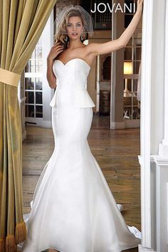 Beautiful strapless satin wedding dress features a sweetheart neckline and peplum side details Available Colors: Ivory Available Sizes: Peplum Wedding Gowns, Wedding Dress Suit, Dream Wedding Dresses, Bridal Dresses, Jovani Dresses, Peplum Dresses, Peplum Gown, Beautiful Gowns, Marie