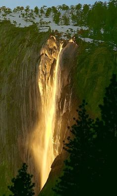 """Every year for a few days in the month of February, the sun's angle is such, that it lights up Horsetail Falls in Yosemite, as if it were o..."