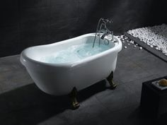 The perfect tub, porcelain with feet and jets.