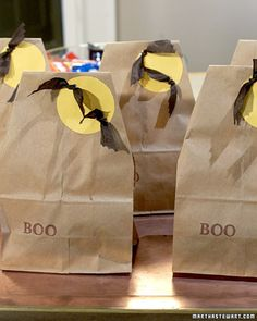 The materials you need to create a trick-or-treat bag, an attractive way to present Halloween party favors, or just a spooky lunch bag are probably already in your house. Follow these simple instructions to embellish a plain brown paper bag with full moons and swooping bats.
