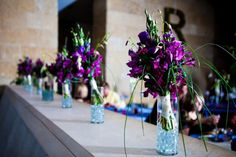 Absolutely stunning bouquets with peacock accents make it both unique and modern. Snap dragons, orchids, peonies combines for rich jewel tones in in purple and eggplant hues.