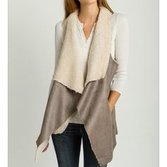 PM Editor Pick Gray Faux Shearling Vest *** Please do not purchase this listing. Leave a comment with your size and I will make you a separate listing :)*** The inside of this vest is SO soft and cozy! • a perfect winter vest to stay warm and look cute! • has pockets as pictured• available in S/M/L • Price is firm for this listing unless bundled Sweaters