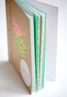 DIY book binding tutorial by Janis Nicolay via Poppytalk. I'm not a huge fan of how she does the binding itself but I love the idea of clipping the pages together and using the awl. I'll have to try that next time.