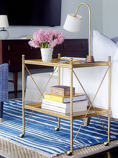 A gold bar cart adds traditional lines as well as surface area for a lamp and drinks.