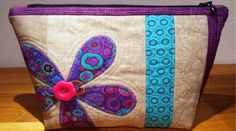 We all need a little sunshine in our lives and when we spotted these cute bags we knew that you would all love them too. This bag features flowers, applique, bright fabrics, pieced panels, scraps o…
