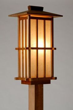 The soft glow of a handcrafted lantern, or andon, will brighten any corner of your home. Each lantern is unique and carefully constructed using traditional Japanese tools. Wooden Lanterns, Wooden Lamp, Candle Lanterns, Wooden Diy, Japanese Lighting, Japanese Lamps, Japanese Furniture, Ästhetisches Design, Lamp Design