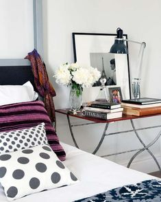 The bedside table all too often gets buried under books you've been meaning to read, remnants of midnight snacks, and boring alarm clocks. However, with just a few styling tricks, that little table can be instantly transformed into an elegant focal point that reflects your design aesthetic. Check out these pretty bedside tables to get some styling inspiration, from non-conventional tables to nightstand essentials.