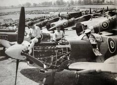 Official RAF photograph taken on 7 June 1944, a day after the invasion in Normandy. It shows rows of factory-fresh Spitfires LF Mk. IXc assembled at a forward repair unit in southern England – place not stated – to replace expected losses of the 2nd Tactical Air Force over the continent. Visible in the far background is an even larger mas of RAF ground vehicles. The mechanics work on the Merlin 66 engine, which is shown to advantage.