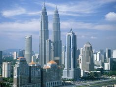 Kuala Lumpur, Malaysia. One of the coolest cities! The twin towers are  one of the tallest buildings in the world. Each tower was built by two guys who were on a race to finish and beat the other person, not a nice thought when your up on the top if you ask me.