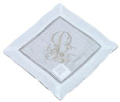 """What is more elegant than entertaining with a beautifully monogrammed crisp linen napkin! These are white with oversized large ecru monogram and floral detail. Where can you find a set of 12 for 40.00! Wonderful gift too with a bottle of wine.  Comes in sets of 12  Color: White linen/Ecru fancy monogram in single letter  Size: 6"""" SQ  Available Letters: A, B, C, D, E, F, G, H, J, K, L, M, N, O, P, R, S, T, V, W, or Y  Please indicate which letter you'd like."""