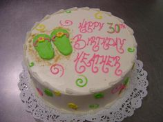 Perfect summer birthday cake with a flip flop and ice cream cone decoration