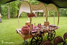 table + cut hula hoops + fabric.  Covered wagons