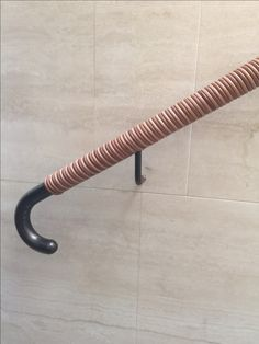 Walpole Handrail: From House of Eroju collection. The Spiral looped leather handrail.