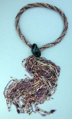Kumihomo... weavershand... would like a longer neck piece, but love the 'tasseled' end