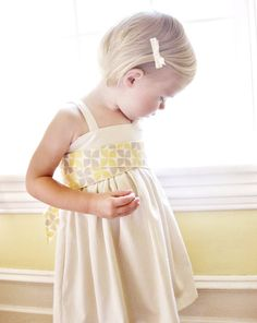 flower girl dresses? we could have these made in another fabric as well.  (I know the shop owner)